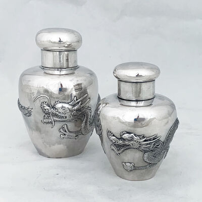 wang hing, 'Two Chinese Export silver caddies with repouse dragon details'
