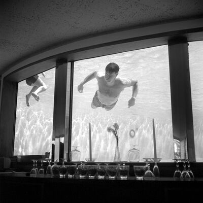 Vivian Maier, '0118353, Man in Bar Swimming', 2014