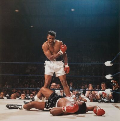 Neil Leifer, 'Muhammad Ali reacts after his first round knockout of Sonny Liston during the 1965 World Heavyweight Title fight at St. Dominic's Arena.Lewiston, Maine'