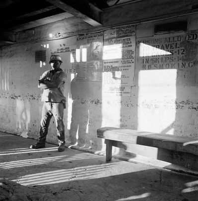 David Goldblatt, 'A miner waits on the bank to go underground, City Deep Gold Mine', 1966
