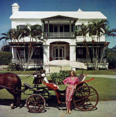 Slim Aarons, 'Bermudan Hostess: Polly Trott Hornburg in front of her father's house', 1957