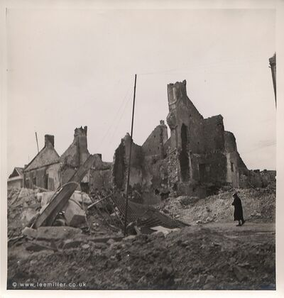 Lee Miller, 'BEHIND THE BATTLEFIELD: An old woman walking through the ruins, Normandy, France', 1944