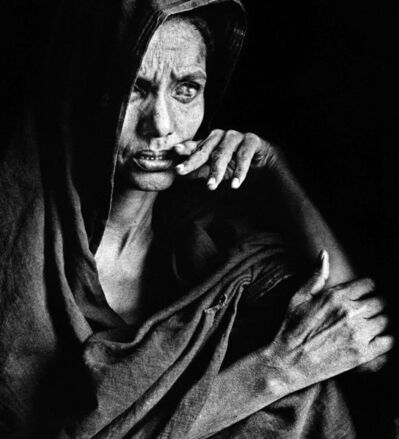 Sebastião Salgado, 'Blinded by sandstorms and chronic eye infections, this woman is waiting for food distribution, Goundam region, Mali', 1985