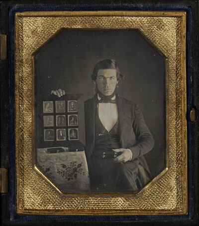 Unknown Artist, 'Portrait of an Unidentified Daguerreotypist Displaying a Selection of Daguerreotypes', 1845