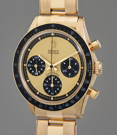 """Rolex, 'An extraordinarily rare, extremely attractive, and important yellow gold chronograph wristwatch with """"Paul Newman Lemon"""" dial and service guarantee', Circa 1969"""