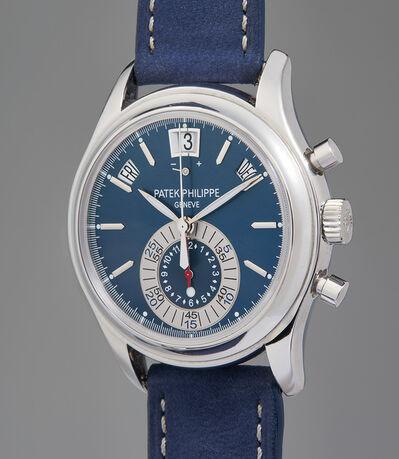 Patek Philippe, 'A very fine and rare platinum annual calendar chronograph wristwatch with blue dial, original Certificate of Origin, and presentation box', 2011
