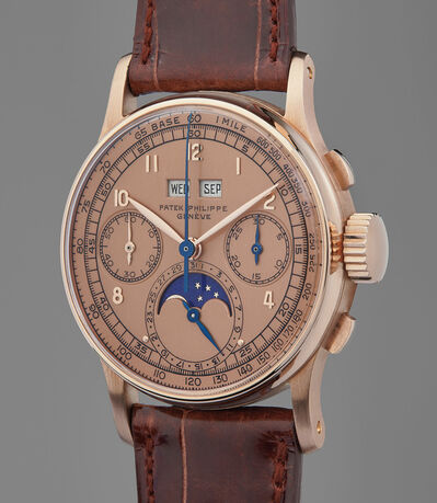 Patek Philippe, 'A previously unknown, extremely rare, and highly attractive pink gold perpetual chronograph wristwatch with pink dial and moon phase', 1947