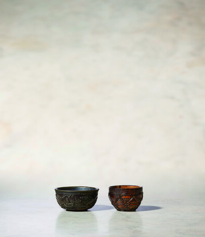 Unknown Chinese, 'A Coco Der Mer Wine Cup of Circular Form (left) 清康熙 海椰殼雕人物酒杯 (左)', China: Kangxi (1662-1722)