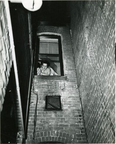 "Weegee, ' ""Woman looks out as cops look for burglar"", Denver', ca. 1940"