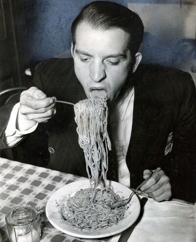 Weegee, 'Phillip J. Stazzone is on WPA and Enjoys His Favorite Food as He's Heard That the Army Doesn't Go in Very Strong for Serving Spaghetti', 1940