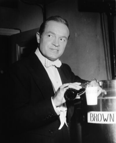 "Murray Garrett, 'Bob Hope Stops for a ""Coke"" backstage while hosting the Academy Awards Show', ca. 1955"