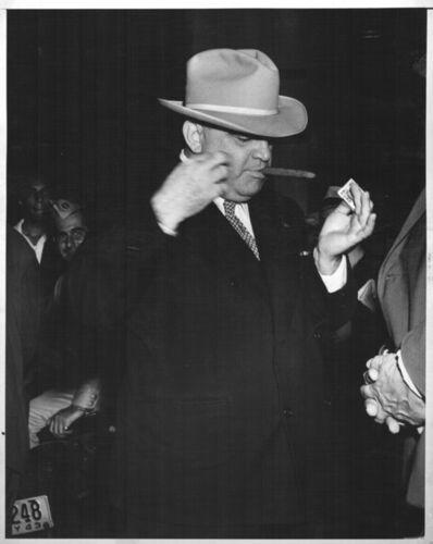 Weegee, 'FIORELLA LAGUARDIA LIGHTNING A CIGAR', ca. 1940