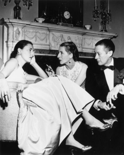 Slim Aarons, 'Park Avenue Party: Slim Hawks, Diana Vreeland, and her husband Reed Vreeland at Kitty Miller's New Year's Eve party in her home on Park Avenue in New York', 1952