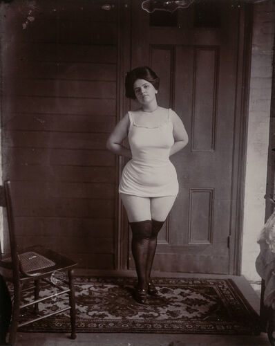 E.J. Bellocq, '[Storyville portrait, New Orleans, woman in underclothes standing on rug, about 1900]'
