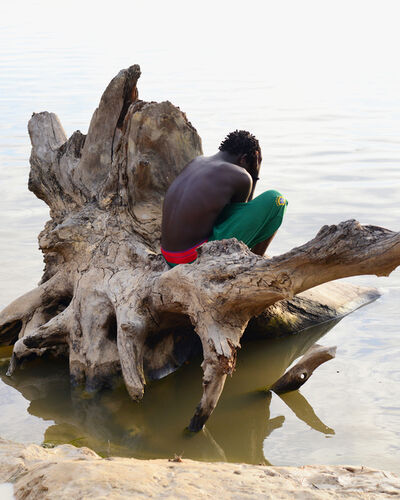 Nicola Lo Calzo, 'Stephano, a young Ndyuka on the bank of Maron river in village of Belicampo,', 2014