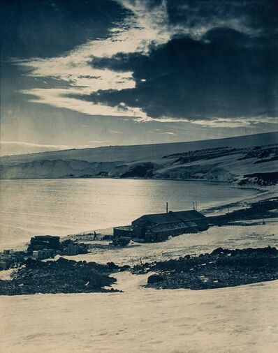 Herbert George Ponting, 'The Hut at Cape Evans, looking over to the Barne Glacier at noon in the fading daylight', 1911