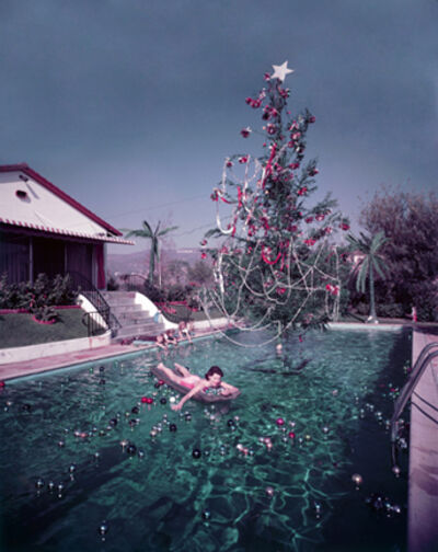 Slim Aarons, 'Christmas Swim, 1954: Rita Aarons swimming in a pool festooned with floating baubles and a decorated Christmas tree, Hollywood, California', 1954