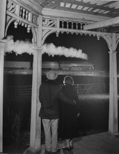 O. Winston Link, 'NW1648 Mr. & Mrs. Benjamin Pope Watch the Last Steam Passenger Train, Max Meadows, VA', December 31-1957