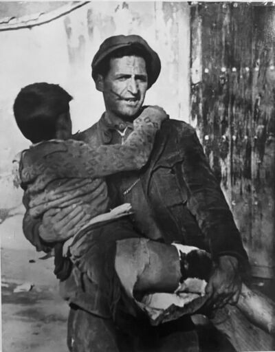 Robert Capa, 'Soldier carrying child, Spanish Civil War', 1937