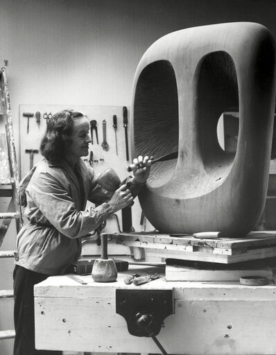 Barbara Hepworth, 'Barbara Hepworth in the Palais studio at work on the wood carving Hollow Form with White Interior', 1963
