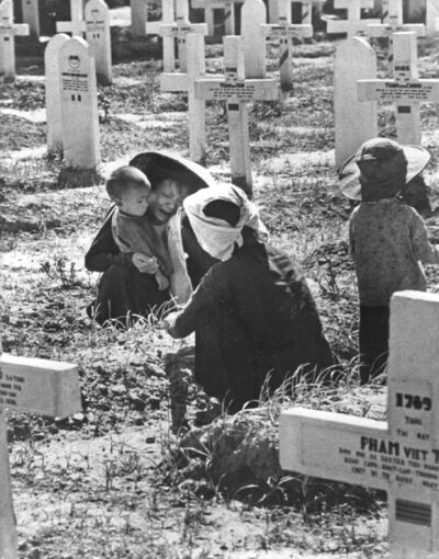 Robert Capa, 'Indochina, 1954. Mourners in a military cemetery for French and Vietnamese soldiers', 1954
