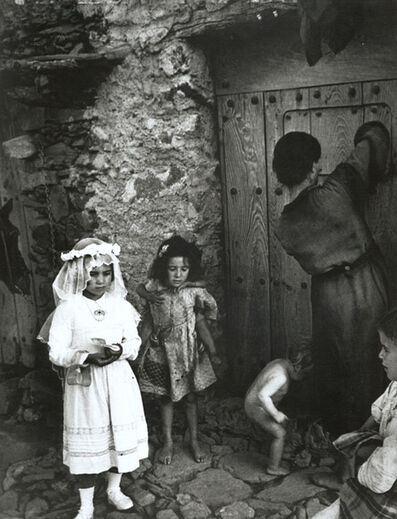 W. Eugene Smith, 'Lorenza Curiel in White First Communion Dress Waiting for Her Mother to Lock Door (from 'Spanish Village')', 1950-51/1970s