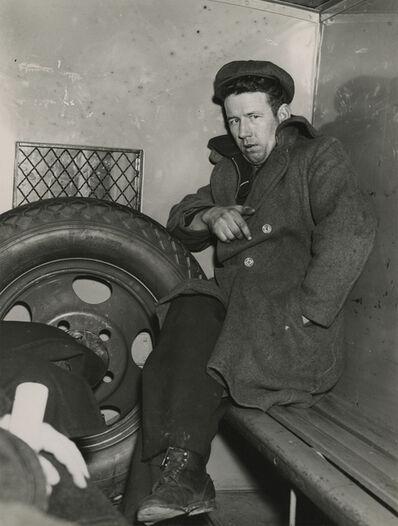 Weegee, 'John Wade, Arsonist, After Police Line-Up in Patrol Wagon', 1940
