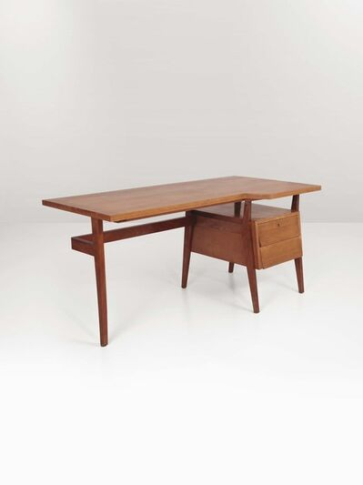 In the style of Gio Ponti, 'A wooden desk with drawers', 1950 ca.