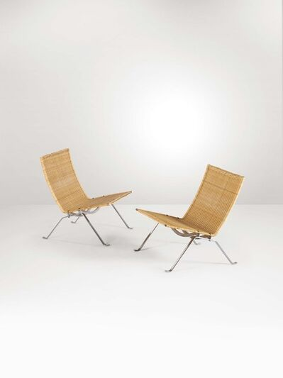 Poul Kjærholm, 'A pair of Pk22 armchairs with a steel structure and rattan pith seats', 1970 ca.