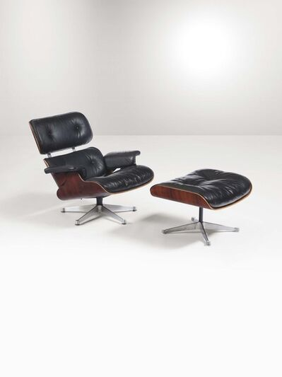 Charles Eames, 'A 670 lounge chair and 671 stool with a fitted and veneered plywood and aluminum shell and leather seat', 1970 ca.