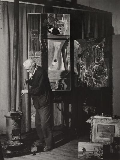 Brassaï, 'Braque au poêle, Derrière, Le Billard, rue de Douanier (Braque by his stove, his painting Le Billard behind, Rue de Douanier)', 1946