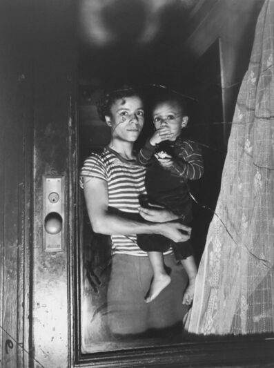 Weegee, 'Mrs. Bernice Lythcott and her one-year-old son Leonard look out a window through which hoodlums threw stones.', October 18, 1943, printed 1981