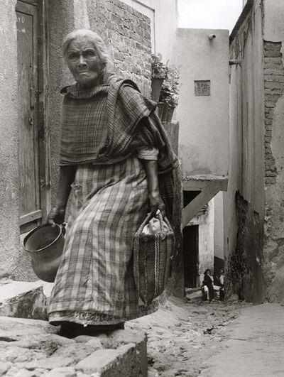 Manuel Carrillo, 'Untitled [Elderly Woman Carrying Empty Jar and Bag]', 1950