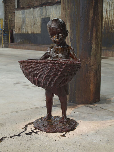 "Kara Walker, 'African Boy Attendant Curio with Molasses and Brown Sugar, from ""The Marvelous Sugar Baby"" Installation at the old Domino Sugar Factory Warehouse. (Front Basket) ', 2014"