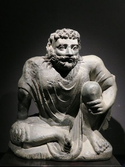 Gandharan, 'Seated Atlas', ca. 2nd-3rd century