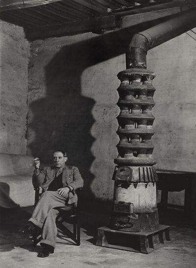 Brassaï, 'Picasso au poêle, rue des Grands Augustin, 6e, Paris (Picasso by his stove, Rue des Grands Augustins, Sixth Arrondissement, Paris)', 1939