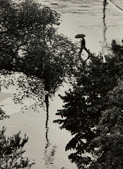 André Kertész, 'Looking Through Trees at Man with Umbrella, August 2', 1962