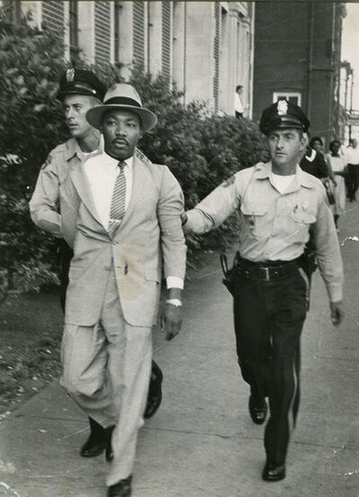 Charles Moore, 'Two Police Officers, Unaware Of Their Prisoner's Identity, Hustle Dr. Martin Luther King Away From The Montgomery Courthouse Where He Had Been Arrested For Loitering', 1958
