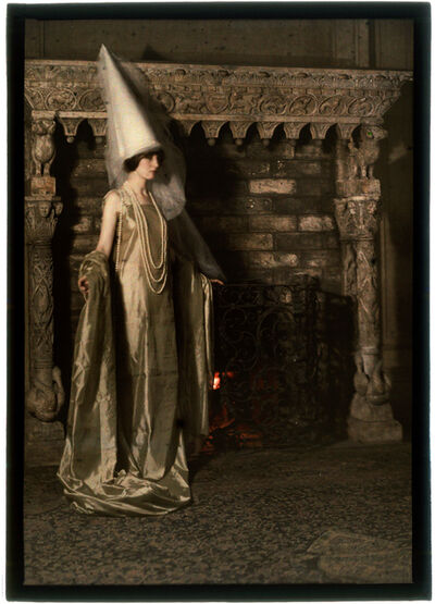 Unknown, 'Woman with a medieval headdress before a Gothic-looking fireplace', ca. 1910