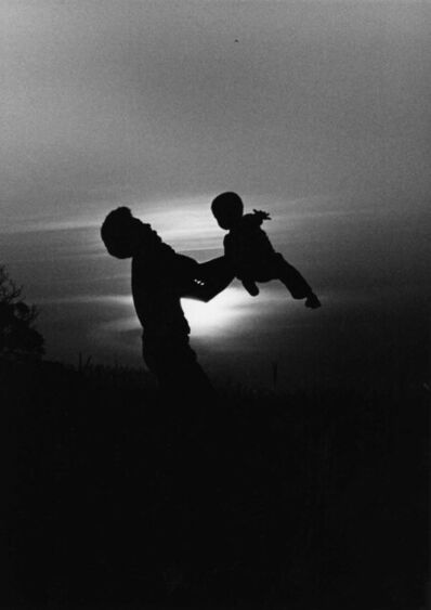 Chester Higgins, Jr., 'Father Swings Son in Sunset, Tuskegee, Alabama', 1973