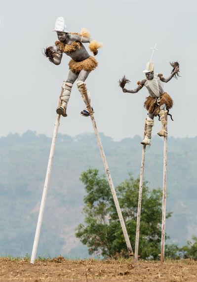 "Carol Beckwith and Angela Fisher, 'Pende ""Tall Men Walking"" Stilt Dancers, Gungu, DR Congo', 2014"