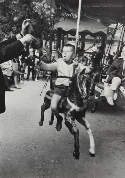 Alfred Eisenstaedt, 'Boy with Tongue Out Spearing Brass Ring, Luxembourg Garden, Paris, 1963', ca. 1964