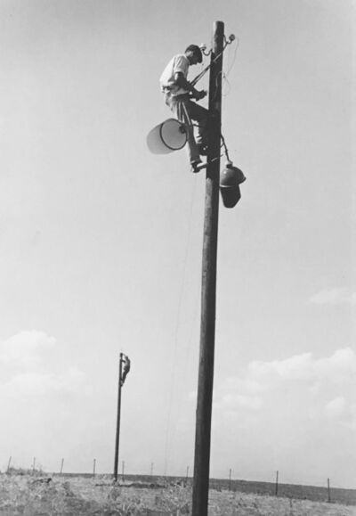 David Seymour, 'Israel, Installing searchlights at the barbed wire perimeter of the settlement of Mishmar Ayolon', 1948