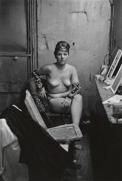 Diane Arbus, 'Stripper with bare breasts sitting in her dressing room, Atlantic City, N.J.', 1961