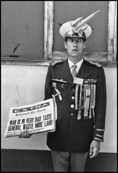 """Dennis Stock, 'Pacifist demonstrating at Santa Monica. """"Waste more land"""" aludes to the name of the US Commander- in- Chief in Vietnam, General Westmoreland. California, USA. '"""