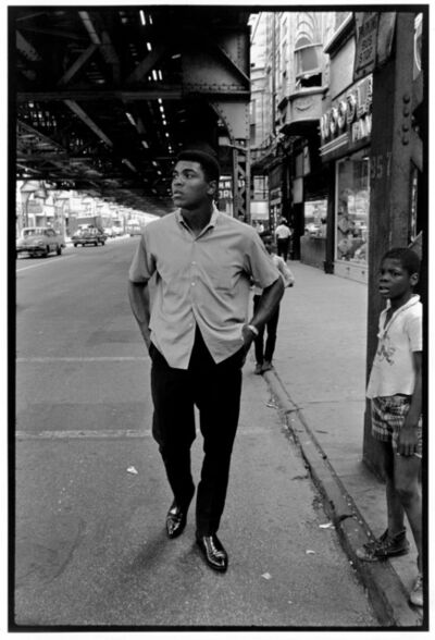 "Thomas Hoepker, 'Ali walking Downtown under Chicago's ""L""', 1996"