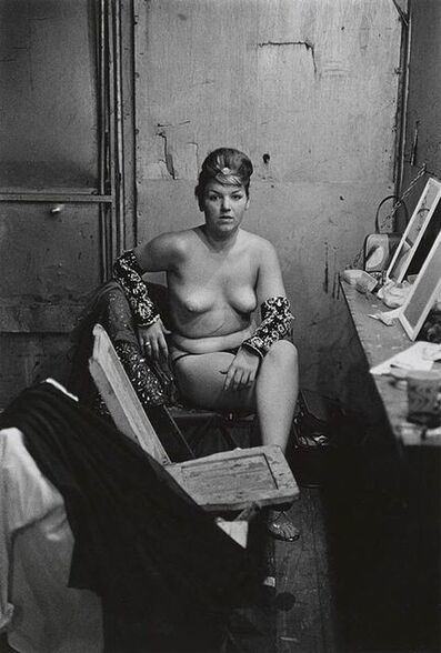 Diane Arbus, 'Stripper with bare breasts sitting in her dressing room, Atlantic City', 1996