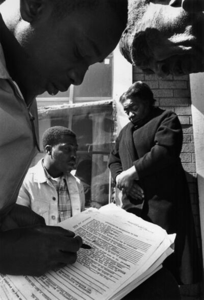 Charles Moore, 'Standing on a porch in the chilly morning air, two voter registration volunteers help a couple with applications. The form then in use asked about criminal convictions and for an interpretation of a section of Mississippi's constitution', 1963-1964