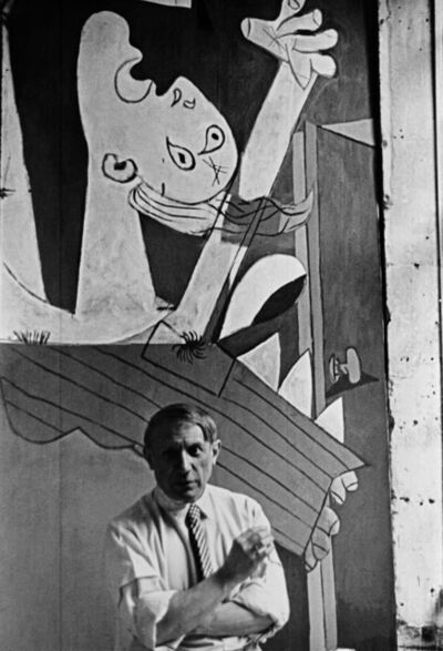 "David Seymour, 'Pablo Picasso in front of his painting ""Guernica"", at its unveiling at the Spanish Pavilion of the International World Fair held six weeks after the aerial bombing of the Basque village of Guernica. Paris, France', 1937"