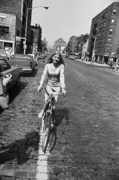 Garry Winogrand, 'Woman Riding Bicycle, from Women are Beautiful Portfolio', 1975